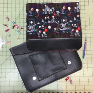 Laura sewing in MADE Makerspace's bay, making clutches