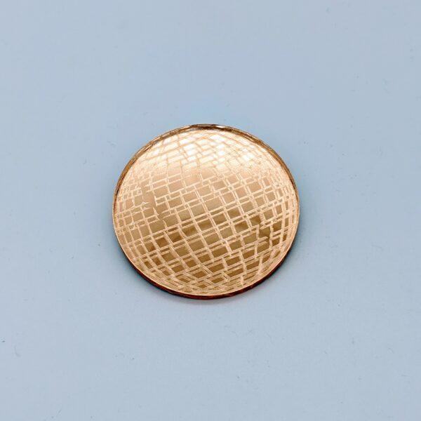 a disco ball acrylic broach by Beqi